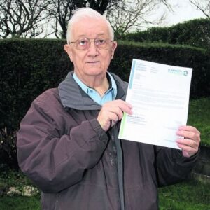 Trevor Harris with his letter from Denbighshire County Council (Credit: Rhyl Journal)