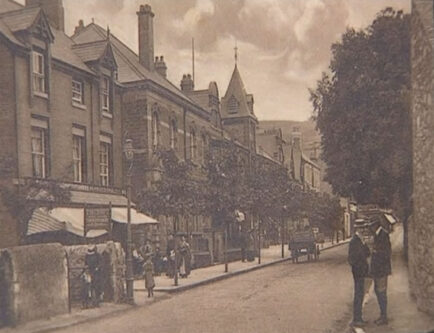 An old photograph of Prestatyn High Street showing the Town Hall/Scala Cinema.